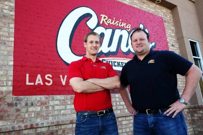 Justin Micatrotto (left) and Joe Micatrotto Jr. of Micatrotto Restaurant Group are photographed Friday, Oct. 29, 2010, outside of their Las Vegas Boulevard location of Raising Cane's.