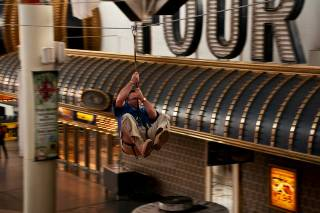 Las Vegas City Councilman Steve Ross zooms 800 feet down the Fremont Street Experience Zip Line on Thursday.