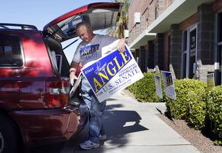 A volunteer loads campaign signs into a vehicle at the West Sahara Avenue campaign headquarters of Republican challenger Sharron Angle on Tuesday, Nov. 2, 2010. The signs will be used for the election night party at the Venetian, he said.