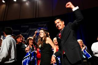Brian Sandoval enters the Red Rock Resort ballroom holding his daughter Madeline's hand after it was announced he defeated Rory Reid for governor Tuesday.