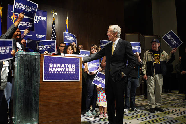Supporters cheer Senate Majority Leader Harry Reid during a news conference at Vdara Wednesday, November 3, 2010.
