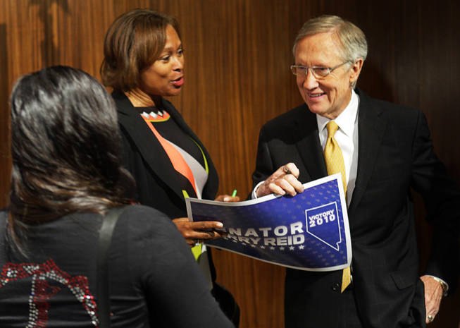 Senate Majority Leader Harry Reid, right, speaks with supporters after a news conference at Vdara Wednesday, November 3, 2010.