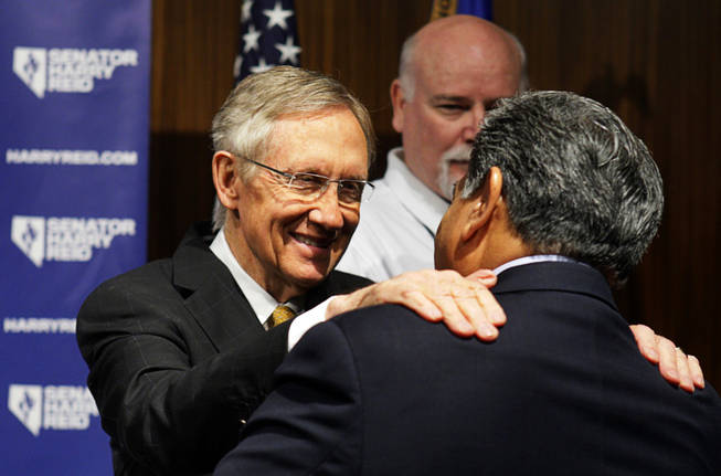 Senate Majority Leader Harry Reid speaks with Fernando Romero, president of Hispanics in Politics, after a news conference at Vdara Wednesday, November 3, 2010.