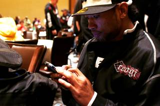 Danny Davis Jr. uses his phone to text messages while waiting for auditions for the 13th season of The Ultimate Fighter Thursday, November 4, 2010.