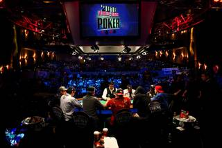 The final table of nine players at the World Series of Poker Main Event play for the $9 million first place prize and the world championship bracelet at the Penn & Teller Theater in the Rio Saturday afternoon.