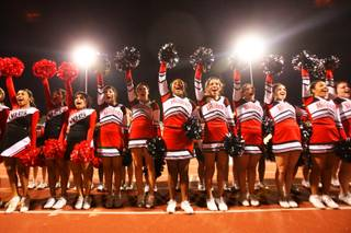 The Las Vegas cheerleaders perform for the fans during the game where their team took on Del Sol Friday during the first round of the playoffs.  Las Vegas advances with a 37-10 victory.