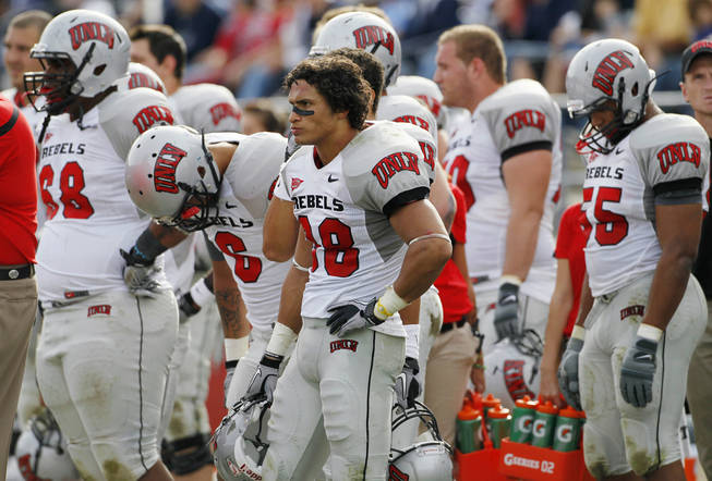 UNLV players, from left, Nate Holloway, Mike Clausen, Calvin Randleman and Nate Carter react during the final seconds against BYU, Saturday, Nov. 6, 2010, in Provo, Utah. BYU defeated UNLV 55-7.