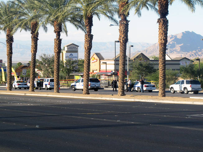 Henderson police investigate a shooting on Boulder Highway near Lake Mead Parkway Saturday afternoon. Officers said a man suspected of robbing a check-cashing store apparently shot himself after police ordered him to leave his car.
