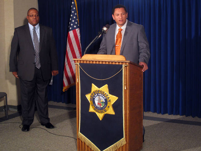 Metro Police Lt. Clint Nichols, from the Robbery Bureau, speaks to the media Saturday about the arrest of suspects in the murder of Eldorado High School teacher Timothy VanDerbosch. At left is Lt. Lew Roberts from the department's Homicide Bureau.