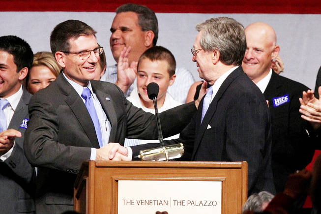"Rep.-elect Joe Heck shakes hands with former Gov. Bob List on Tuesday at the Venetian. Of his voting decisions in Congress, Heck said, ""If this is going to be something that's going to be good for my children, then I think it's probably going to be good for most Americans."""