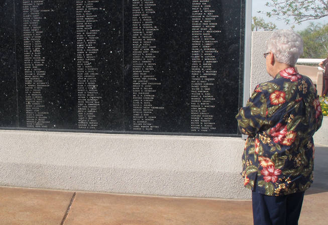 Henderson resident Joyce Nies looks at the Henderson Veterans Memorial Wall following the city's annual Veterans Day Ceremony. Both of Nies former husbands served in the military.