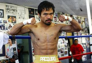 Filipino boxer Manny Pacquiao poses during a workout at the Wildcard Boxing Club in Hollywood, Calif. Monday, November 8, 2010. Pacquiao takes on Antonio Margarito at Cowboys Stadium in Arlington, Texas on Saturday, November 13.