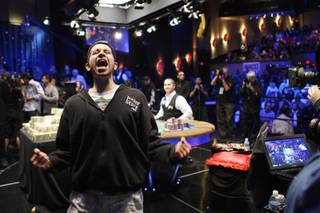 Jonathan Duhamel of Canada celebrates after beating John Racener in the finals of the World Series of Poker Main Event at the Rio on Monday, November 8, 2010. Duhamel won the championship bracelet and $8.9 million in prize money.
