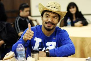 Filipino boxer Manny Pacquiao gives a thumbs up Wednesday night after the final press conference in Dallas November 10, 2010.