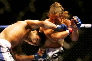 Urijah Faber and Takeya Mizugaki trade blows during their bout at WEC 52 Thursday, November 11, 2010 at the Palms.