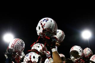 Liberty celebrates after defeating Canyon Springs 26-13 Thursday in the Sunrise semifinal.