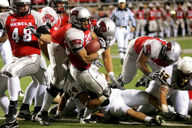 UNLV running back Tim Cornett falls across the goal line during the Rebels' Mountain West Conference game against Wyoming on Saturday, Nov. 13, 2010, at Sam Boyd Stadium.