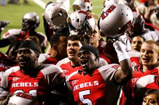 UNLV football players sing the UNLV fight song after handing Wyoming a 42-16 loss during their Mountain West Conference game Saturday, November 13, 2010 at Sam Boyd Stadium.