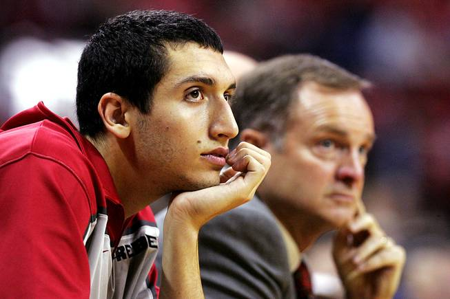 UNLV freshman wing Karam Mashour sits on the bench next to head coach Lon Kruger during the Rebels' season opener against UC Riverside Friday, November 12, 2010 at the Thomas & Mack Center. Mashour has decided not to redshirt his freshman season.