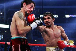 Manny Pacquiao, right, of the Philippines connects on Antonio Margarito during their WBC super welterweight title fight at Cowboys Stadium in Arlington,Texas Saturday, November 13, 2010. Pacquiao won the 12-round fight by unanimous decision.