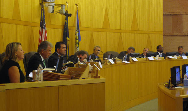 A nine-member panel meets Oct. 18 in the Clark County Commission chambers to discuss the coroner's inquest process and listen to public feedback. From left are Margaret McLetchie, Bill Maupin, John Fudenberg, David Roger, Christopher Blakesley, Doug Gillespie, Phil Kohn, Richard Boulware and Chris Collins.