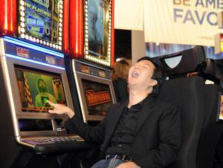 Hangover star Ken Jeong debuts IGT's slot machine based on the blockbuster movie at Global Gaming Expo (G2E) 2010 at the Las Vegas Convention Center on Nov. 16, 2010.