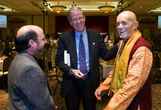 Father Ron Zanoni, left, pastor of St. Christopher Catholic church in North Las Vegas,  Gard Jameson, center, associate pastor of the Grace Community Church in Boulder City, and Swami Ramananda of the Hindu Society of Nevada, chat before the Mayors Prayer Breakfast, an event that is supposed to develop leadership skills in Las Vegas' youth, at Texas Station Thursday, November 18, 2010. The event modeled after the National Prayer Breakfast in Washington, D.C.