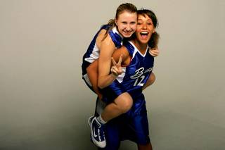 Basic basketball players Kelsey Gunther and Kailai Brantner