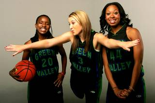 Green Valley basketball players Mackenzie Butler, Shavon Stevens and Angelica Mack.