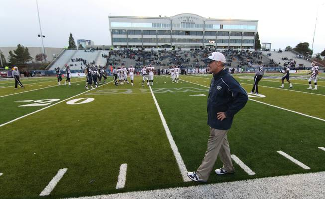 Nevada Head Coach Chris Ault walks the sidelines in the final minutes of Saturday's NCAA football game agaist New Mexico State on Nov. 20, 2010 in Reno, Nev. The 52-6 victory was Nevada's 500th win.