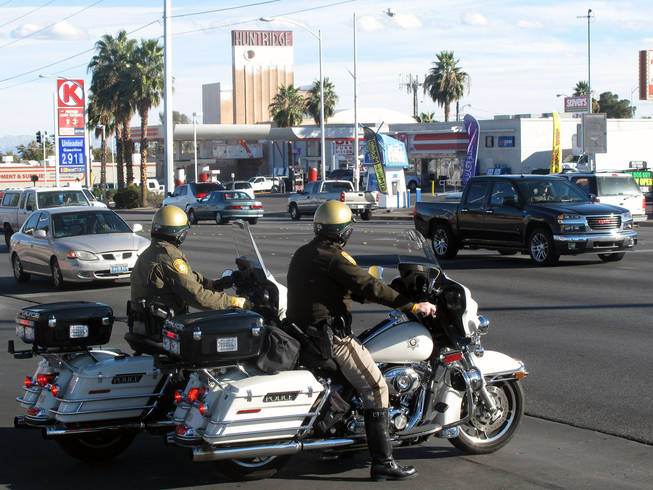 Metro Police officers watch traffic during a crosswalk enforcement campaign Tuesday on Charleston Boulevard.