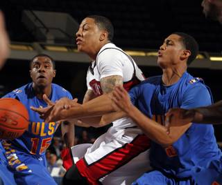 UNLV's TreVon Willis (center) battles Tulsa defenders Justin Hurtt (15) and Jordan Clarkson in the first half at the 76 Classic in Anaheim, Calif., on Thursday, Nov. 25, 2010.