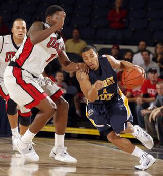 Murray State guard B.J. Jenkins, right, drives around UNLV forward Quintrell Thomas during the first half at the 76 Classic in Anaheim, Calif., Friday, Nov. 26, 2010.