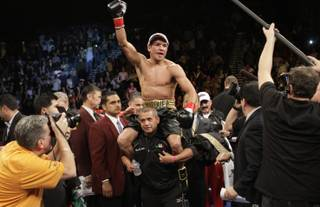 WBA/WBO lightweight champion Juan Manuel Marquez of Mexico celebrates his victory over Michael Katsidis of Australia during a title fight at the MGM Grand Garden Arena on November 27, 2010.