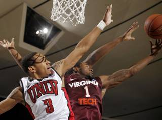 UNLV guard Anthony Marshall, left, and Virginia Tech guard Terrell Bell vie for a rebound at the 76 Classic in Anaheim, Calif., Sunday, Nov. 28, 2010.