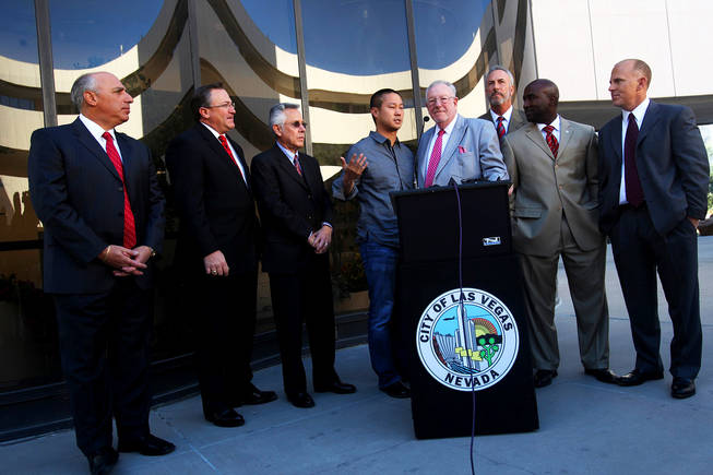 Zappos CEO Tony Hsieh, Las Vegas Mayor Oscar Goodman and members of the Las Vegas City Council answer questions in November 2010 at the Las Vegas City Council meeting, when it was officially announced the existing City Hall building would be used as the corporate headquarters for online retailer Zappos.com.