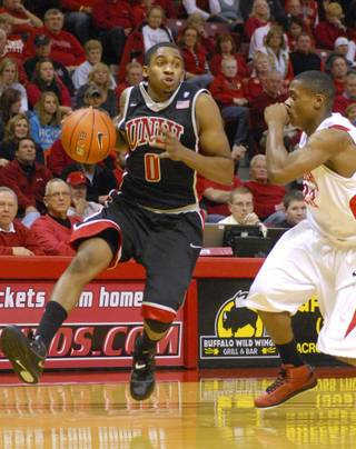 UNLV's Oscar Bellfield (0) drives around Illinois State's Kenyon Smith during Wednesday's game in Normal, Ill.