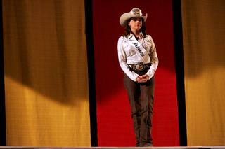 Miss Rodeo Arizona Kasey Jo Painter waits for her cue as she rehearses for the Miss Rodeo America Pageant on Wednesday, Dec. 1, 2010.