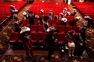 Miss Rodeo contestants take a break as they rehearse for the Miss Rodeo America Pageant on Wednesday, Dec. 1, 2010.