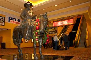 A statue of Benny Binion, a key figure in bringing the National Finals Rodeo to Las Vegas, stands at the entrance to the NFR welcome reception at South Point on Tuesday, Nov. 30, 2010.