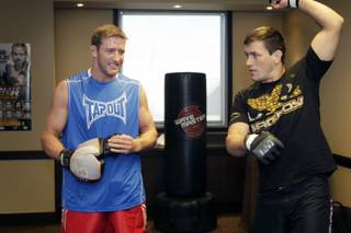 Light heavyweight fighter Stephan Bonnar, left, chats with middleweight Demian Maia as they warm up for  a media workout at the Palms Thursday, December 2, 2010. Bonnar faces Igor Pokrajac in the TUF 12 Finals at the Palms Saturday.