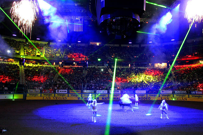 Pyrotechnics, lasers and dancers entertain the crowd at the start of the first go round of the National Finals Rodeo Thursday, December 2, 2010 at the Thomas & Mack.