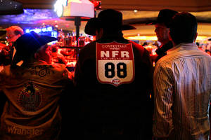 Cowboys belly up to the bar during an after-party at The Mirage sports book following the first go-round of the National Finals Rodeo on Thursday, Dec. 2, 2010.