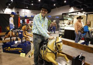 Cowboy John John Katsilometes finds a ride he can handle at The Ride Guys booth during the Cowboy Christmas Gift Show at the Las Vegas Convention Center Friday, December 3, 2010. The show, affiliated with the Wrangler National Finals Rodeo, runs through Saturday, December 11th.