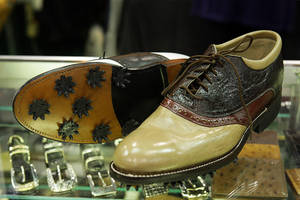 Custom-made golf shoes ($750) are displayed at the Loveless Custom Boots and Shoes booth during the Cowboy Christmas Gift Show at the Las Vegas Convention Center on Dec. 3, 2010. The show, affiliated with the Wrangler National Finals Rodeo, runs through Dec. 11.