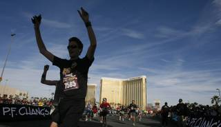 Runners cross the finish line during the Las Vegas half-marathon Sunday, Dec. 5, 2010, in Las Vegas.