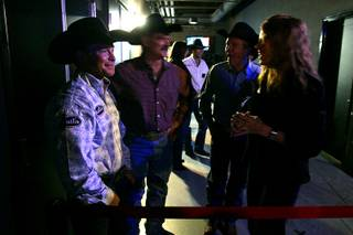 Bareback winner Wes Stevenson waits backstage to be called out to receive his prizes during the Montana Silversmiths Go-Round Buckle Presentations at the South Point Tuesday, December 7, 2010.