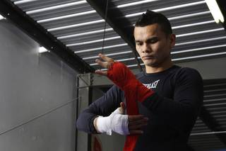 Super lightweight boxer Marcos Maidana of Argentina wraps his hands before a workout in Las Vegas, Wednesday, December 8, 2010. Maidana will take on Amir Khan of England in a WBA super lightweight title fight at the Mandalay Bay Events Center on Saturday.