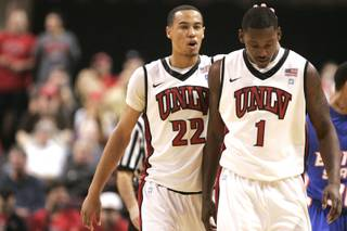 UNLV guard Chace Stanback pats teammate Quintrell Thomas on the head during their game against Boise State at the Orleans Arena Wednesday, December 8, 2010. UNLV held off a late surge to win 75-72 and improve to 9-0.