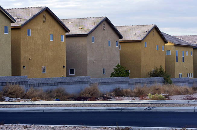 "The rear of homes in an a complex in the southwest part of the Valley. ""It looks like a third-grade drawing,"" says architect Robert Fielden. Photographed December 9, 2010."